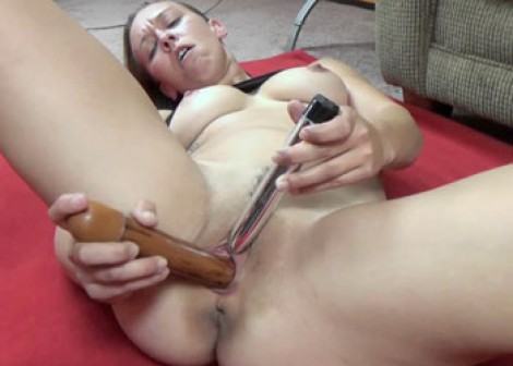 Nicci Taylor gets off with a pair of dildos